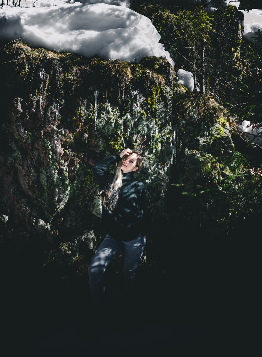 standing woman surrounded by plants