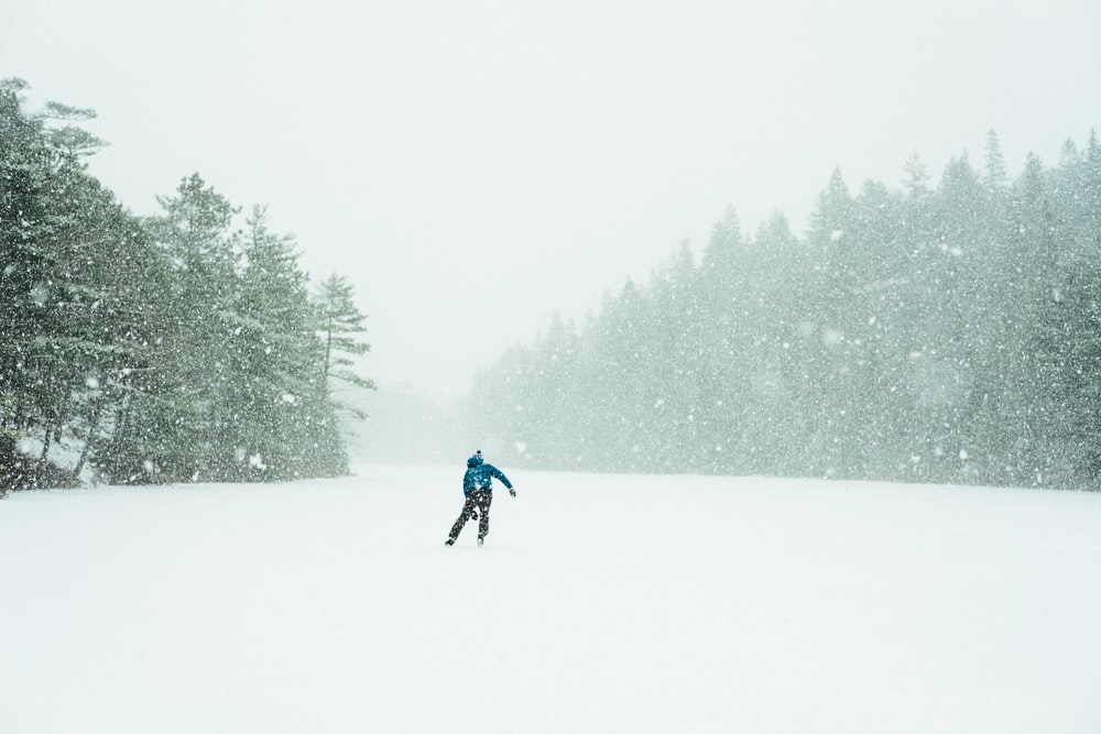 man about to ski surrounded by snows