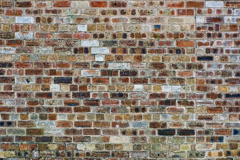 photo of black and brown concrete brick wall