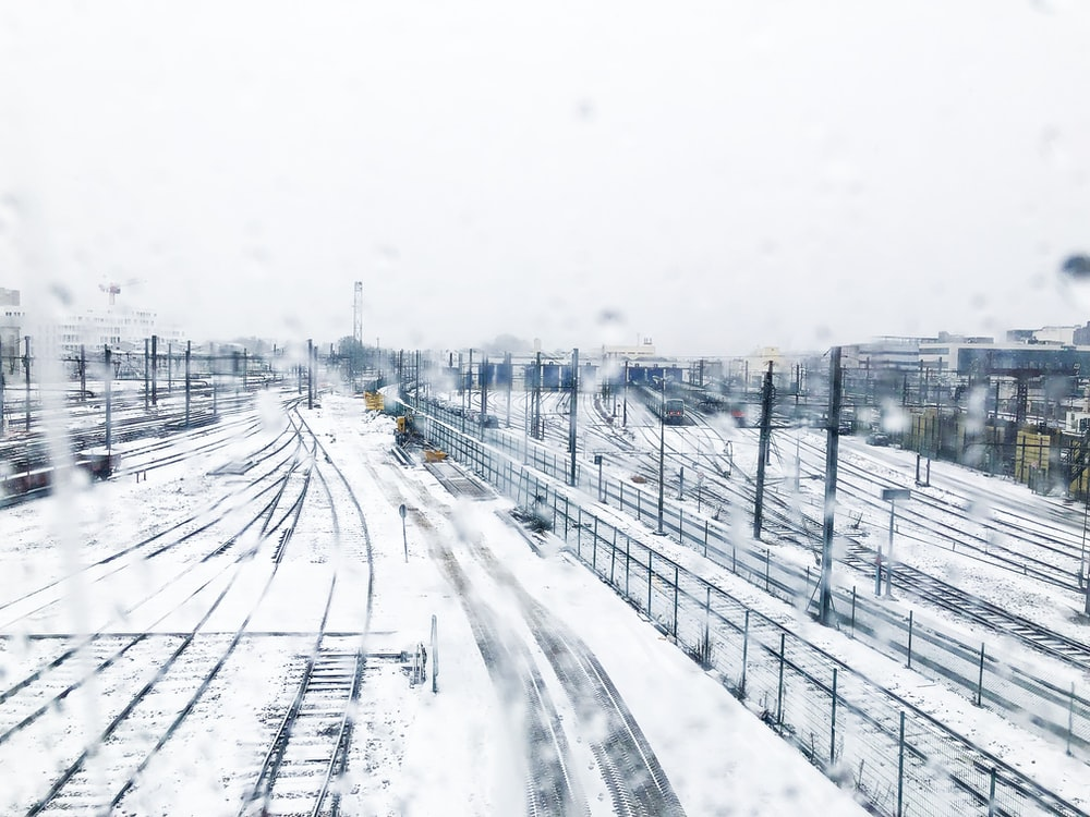 snow covered railway during daytime