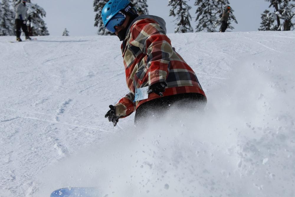 snowboarder on slope wearing blue helmet