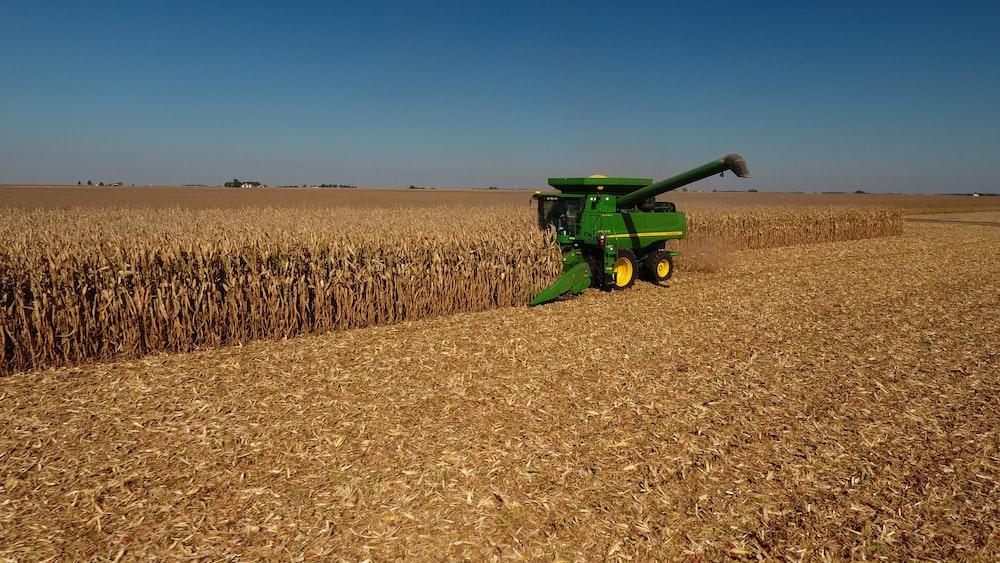 John Deere plow beside dried field