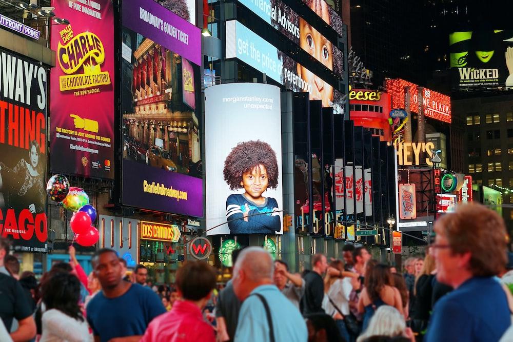 people walking on road during nighttime