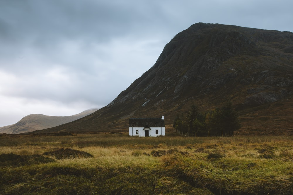 white and black house near mountai n