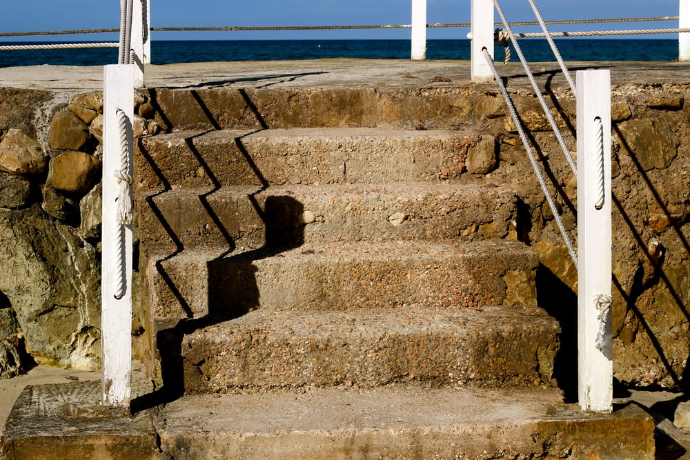 brown concrete stairs during daytime