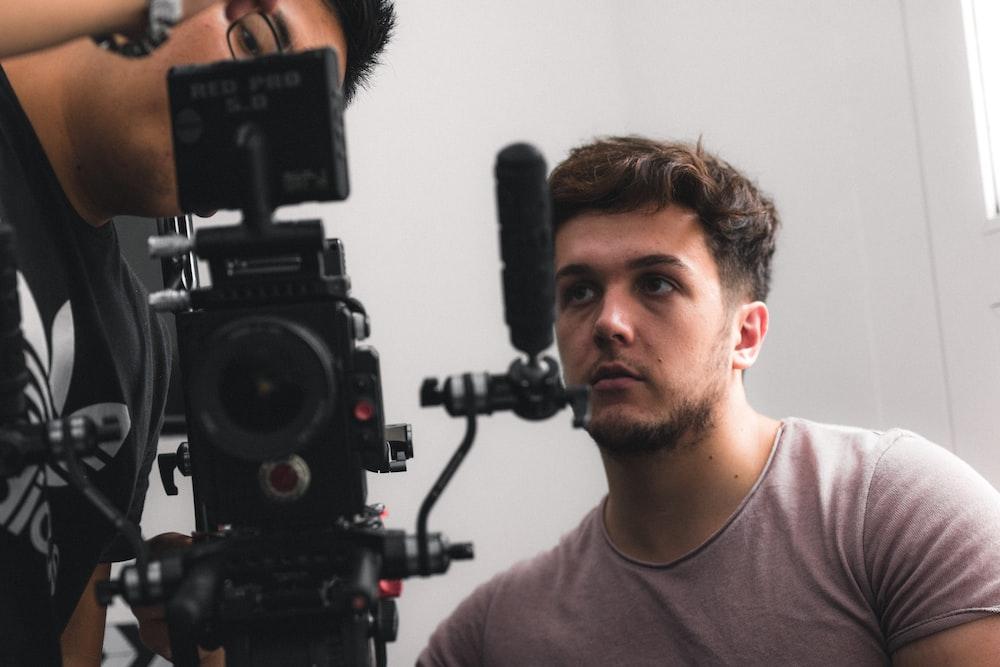 two man staring at camera