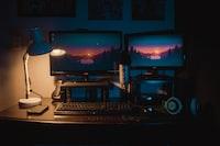 pair of black computer monitors