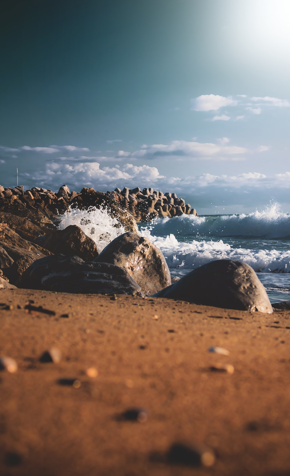 sea waves hitting on rock formations