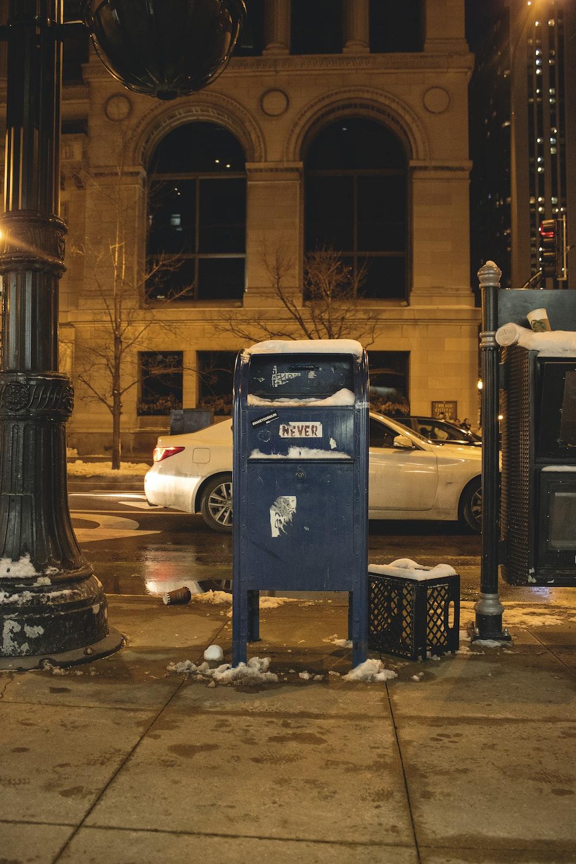 blue metal trash bin