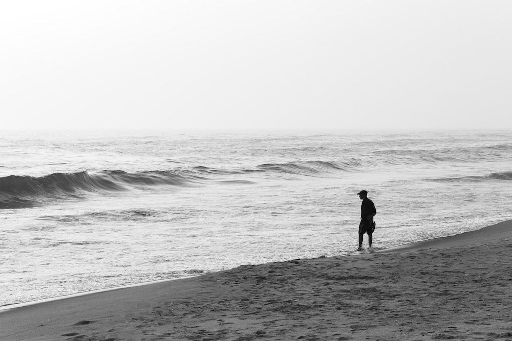 man standing at the seasore