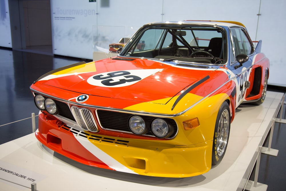 orange and yellow BMW coupe