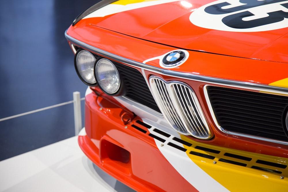 orange BMW vehicle