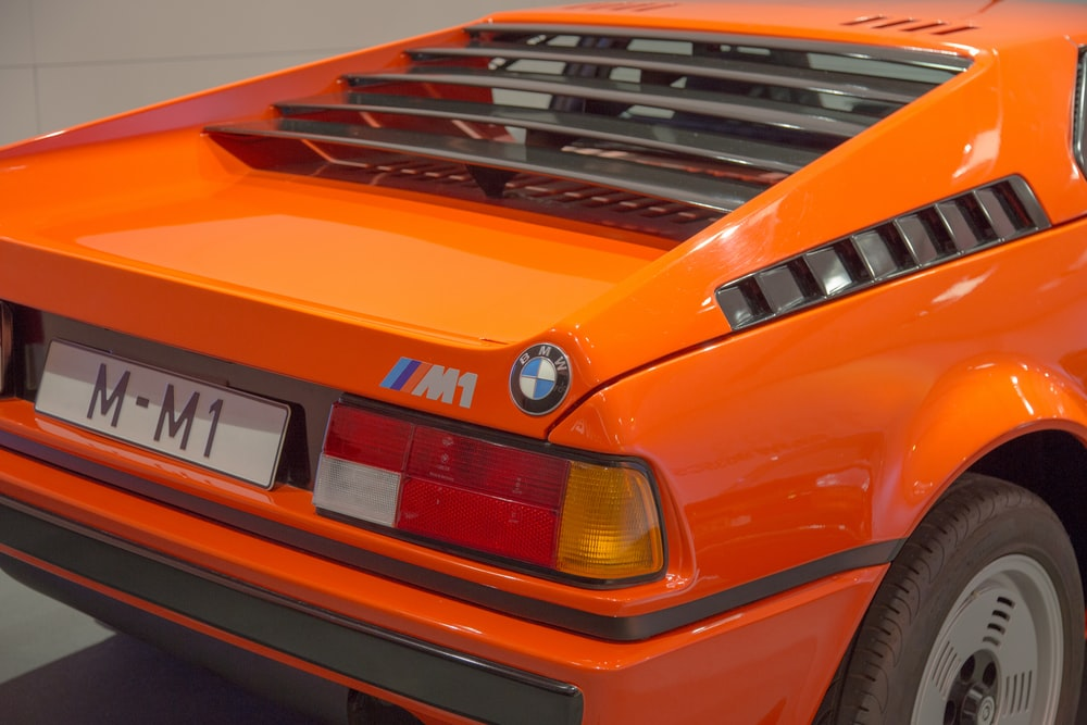 orange BMW M1 vehicle