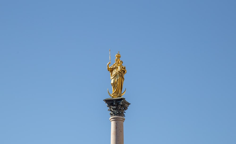 gold statue on top of pedestal