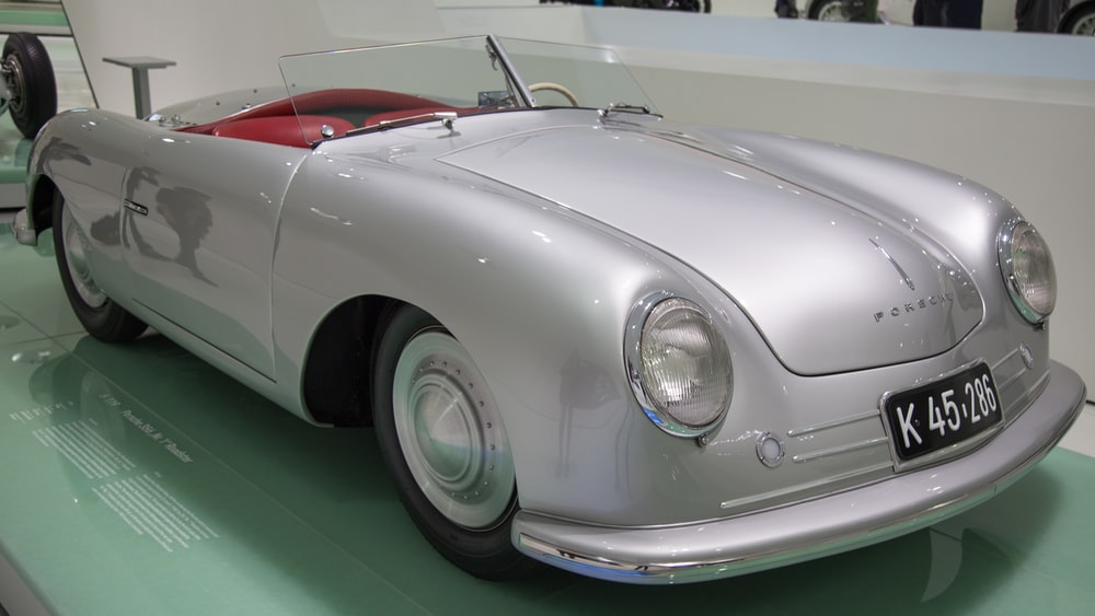 gray convertible car with plate no. K 45 286