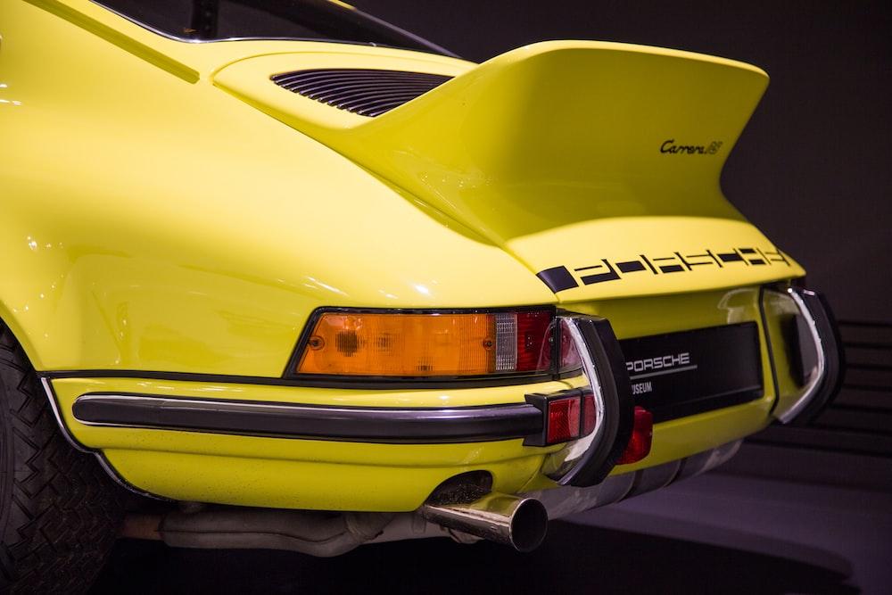 yellow Porsche coupe