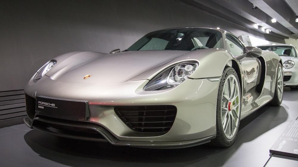 silver luxury car inside building