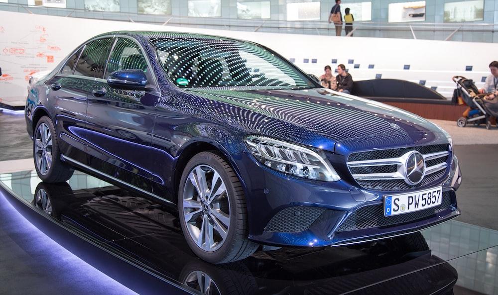 parked blue Mercedes-Benz car