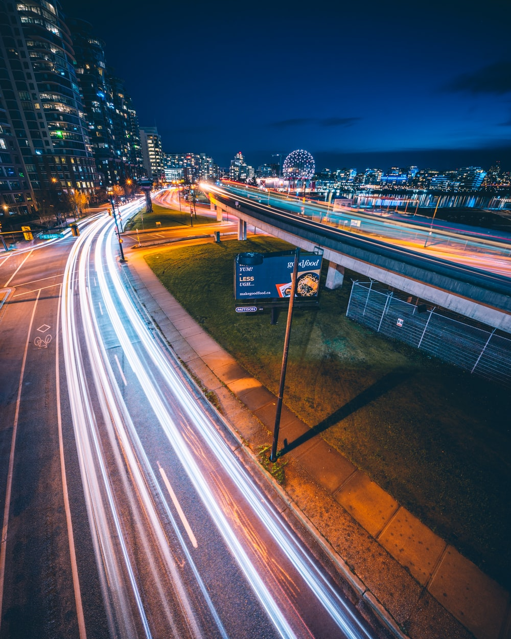 time lapse photography of cars passing on road