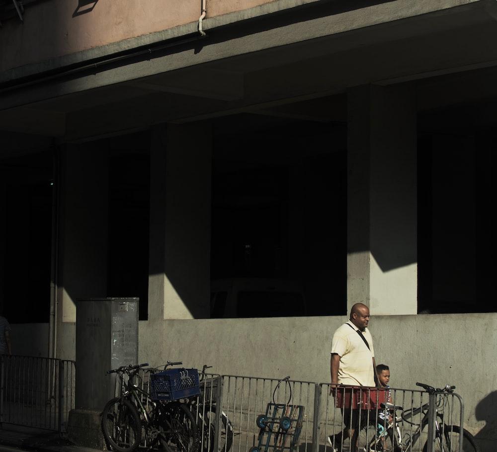 man and boy walking beside building