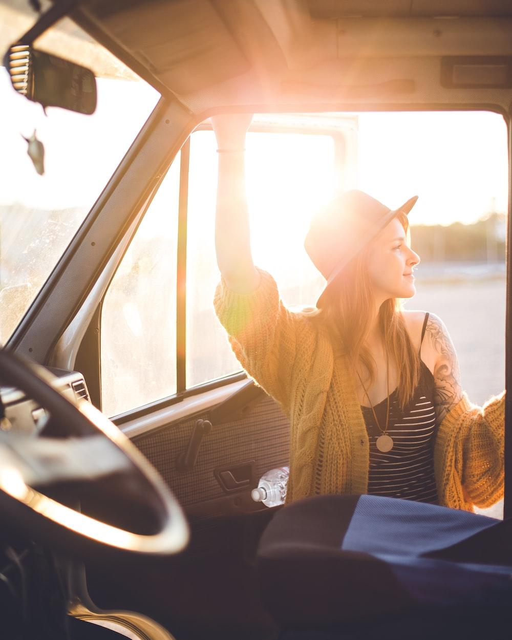 woman standing beside vehicle door