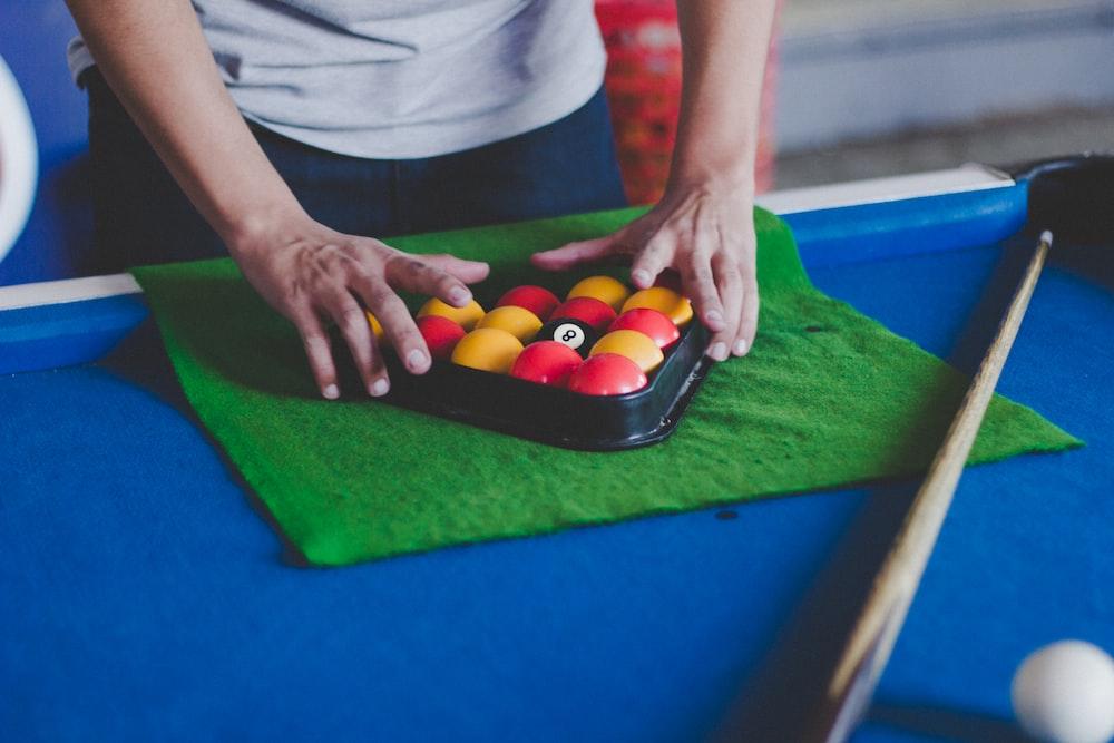 man fixing billiard balls
