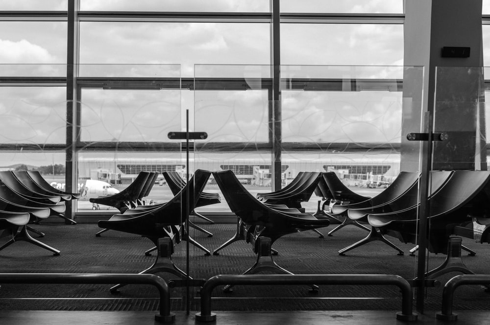 grayscale photography of empty chairs