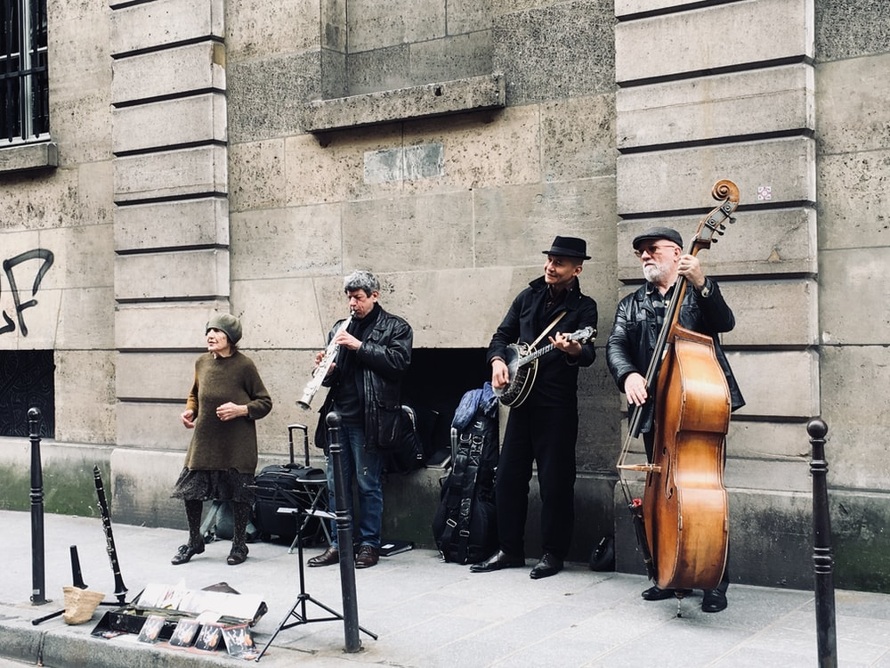 four men playing instruments