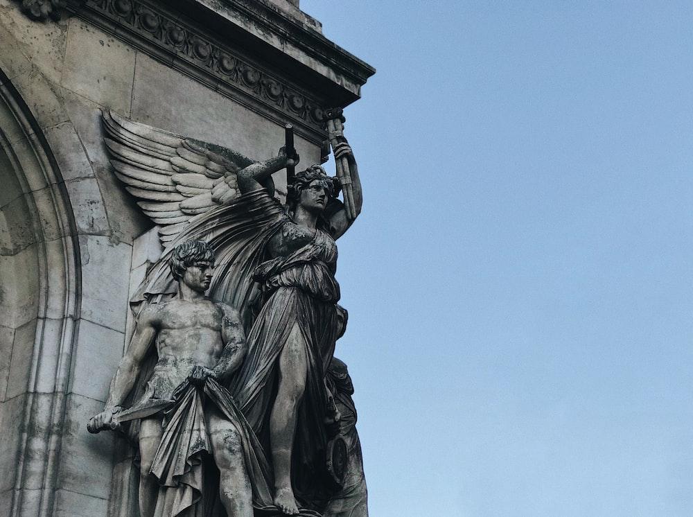 angle beside man statue