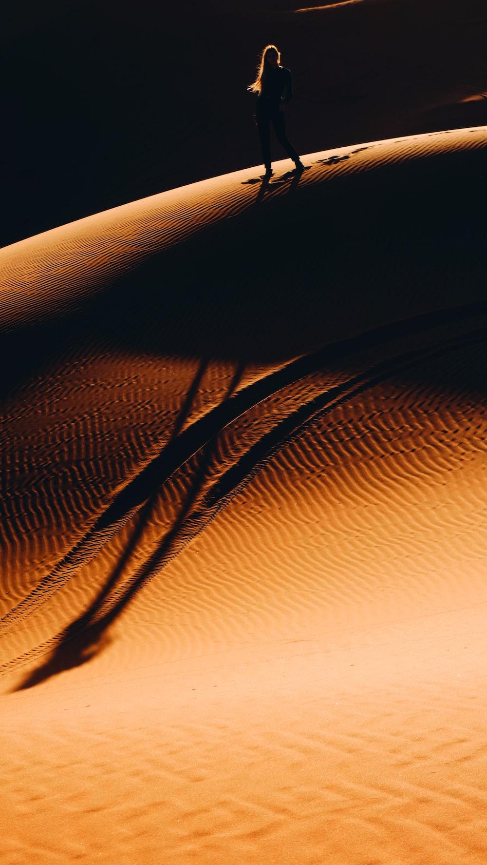 woman walking on desert