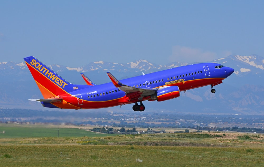 blue and red Southwest passenger airline in flight