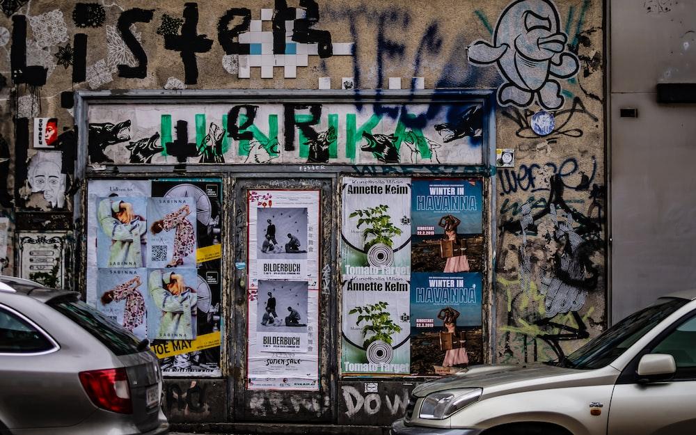 gray vehicle beside wall
