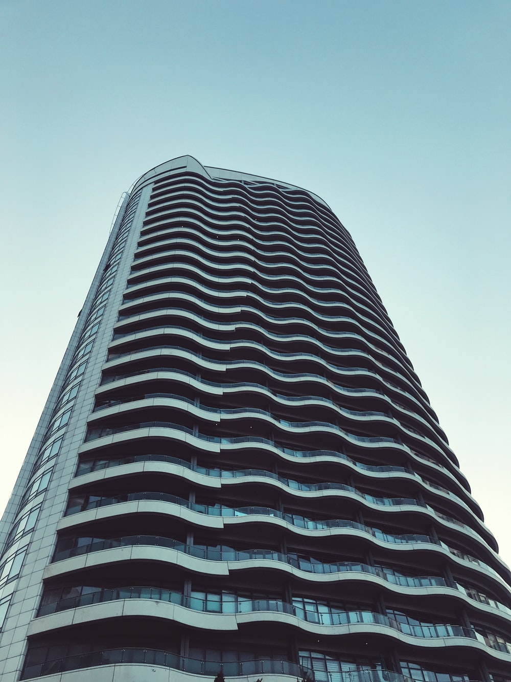 worms-eye view of gray tall building