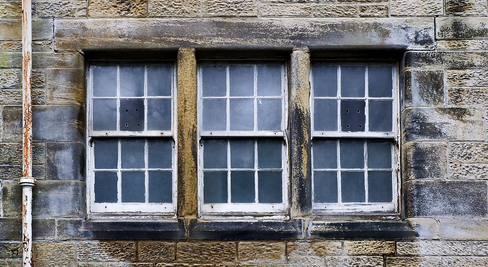 closed white wood-framed glass windows