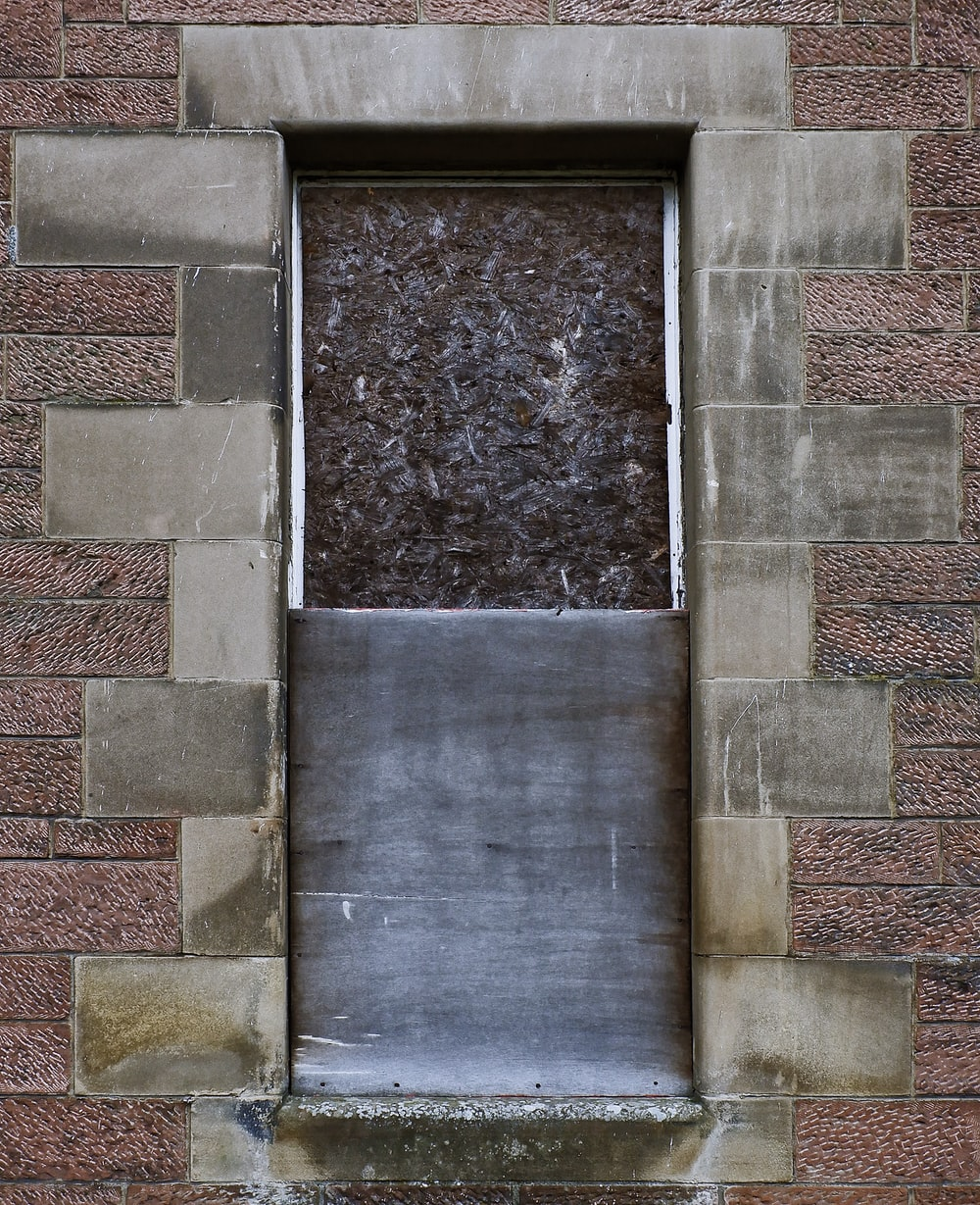 window on brown bricks