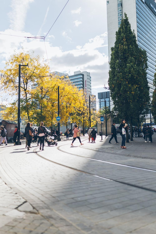 people walking beside concrete building