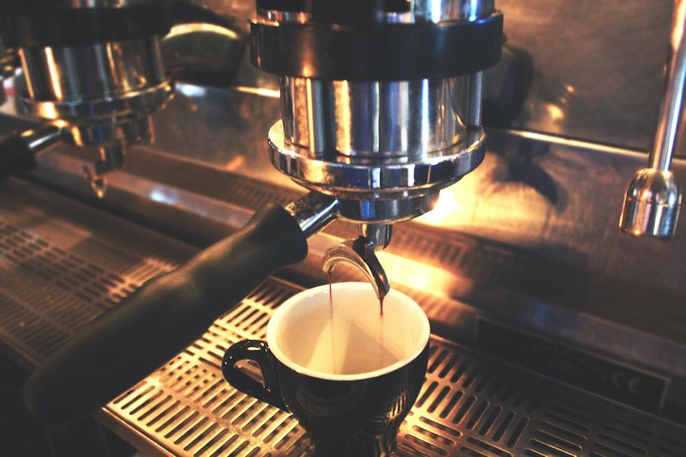 black mug on coffee maker