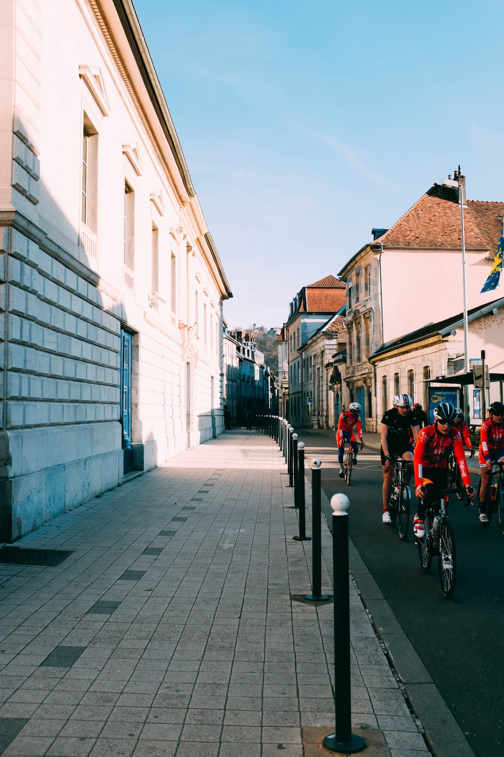 group of cyclist on street during daytime
