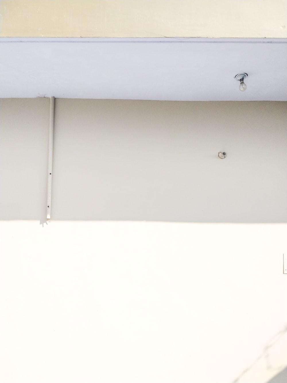 single light bulb on white ceiling
