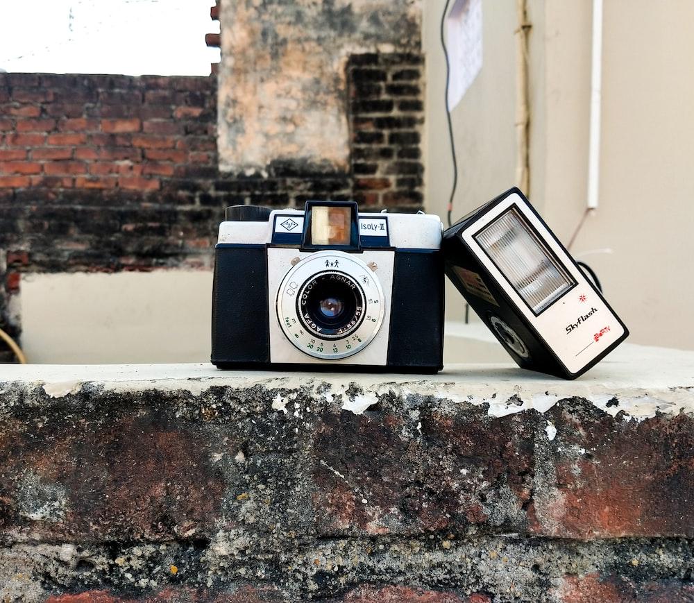 gray camera on brick wall