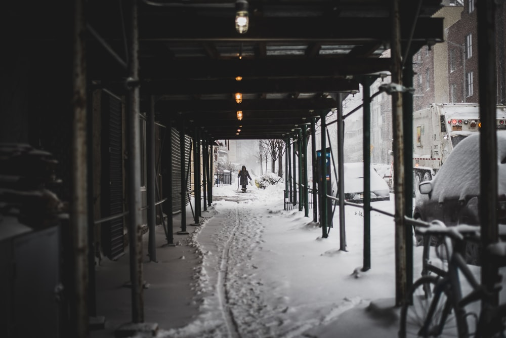 person walking on hallway covered in snow