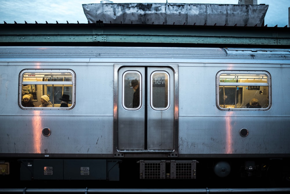 single perspective photography of gray train