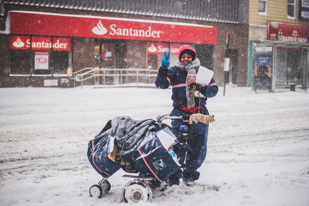person standing beside stroller