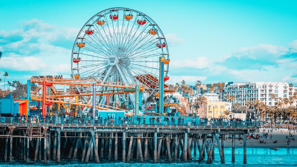 blue Ferris wheel across buildings