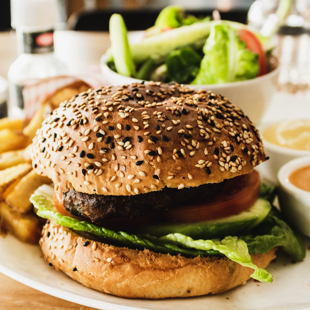 burger with tomato, lettuce, and fries