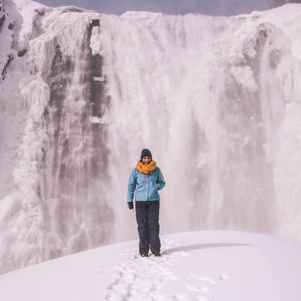 woman walking on icy surface
