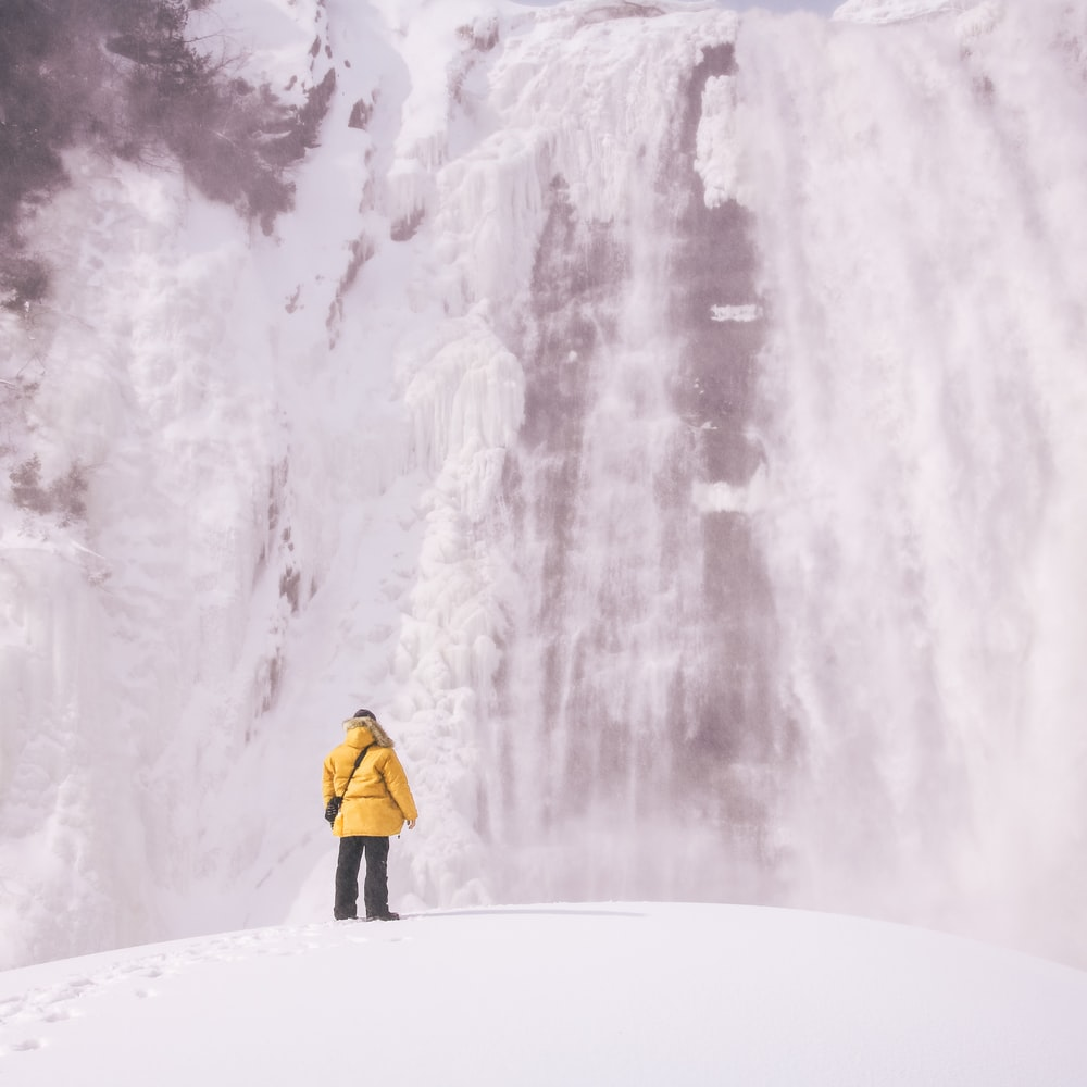 person standing front of waterfalls