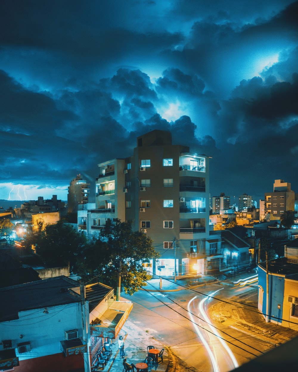 beige concrete building under dark clouds