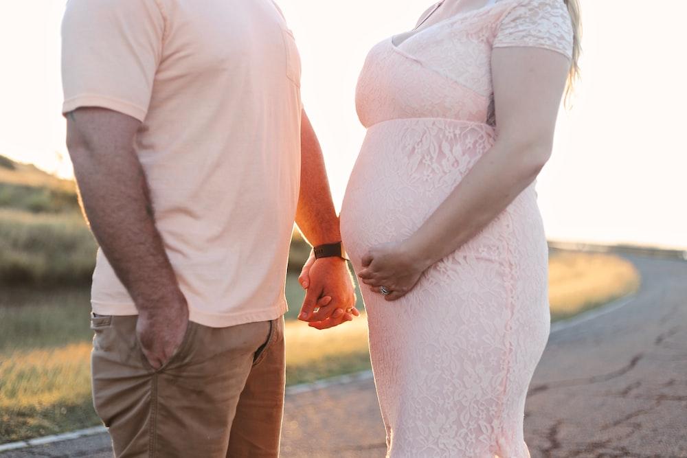 man holding woman's hand
