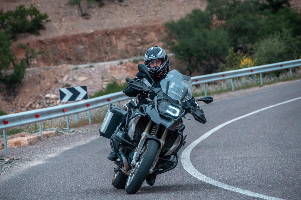 man riding motor rider